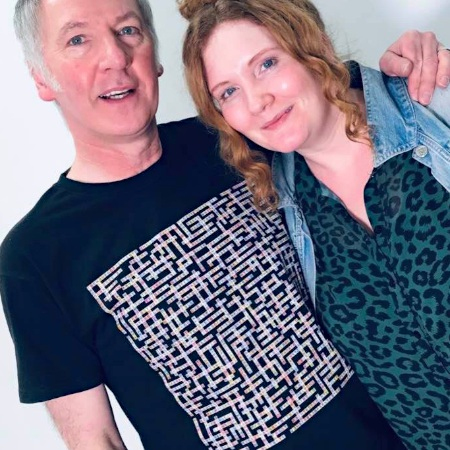 photo of clint boon wearing manchester bands name-chains black t-shirt with jennie mcalpine