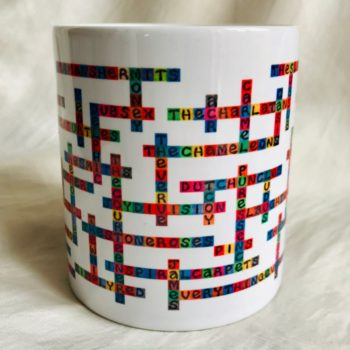 image of manchester bands name-chains mug showing front of mug with handle hidden at the back
