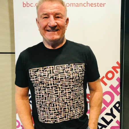 image of mike sweeney wearing manchester bands name-chains black t-shirt